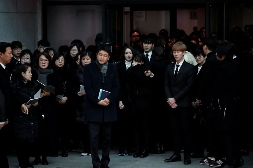 Relatives and celebrities react at the funeral of Kim Jong Hyun, lead singer of top South Korean boy band SHINee.