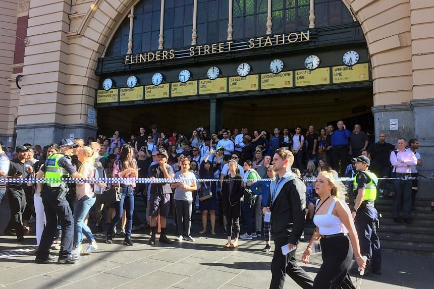 Flinders Sreet Station is blocked by the police following the car incident.