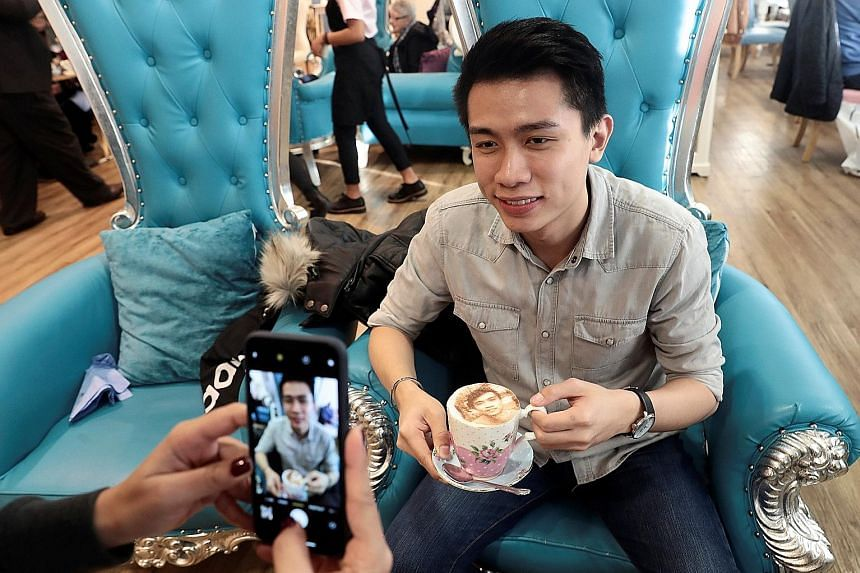 A customer poses for a photo with his Selfieccino coffee at The Tea Terrace in London.