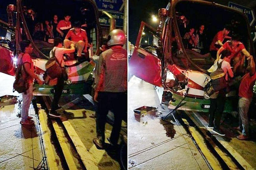 Above: Mr Shen Zhongsheng's car was crushed by two trailers after a passenger bus hit the one behind him, causing a chain collision in Woodlands Crossing yesterday morning that left 26 people injured. Below: Passengers climbing out of the bus after t