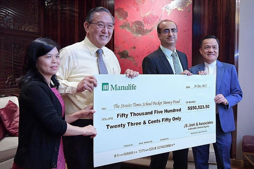 (From left) ST School Pocket Money Fund general manager Tan Bee Heong and Charity Council chairman Gerard Ee receiving the cheque from Manulife Singapore president and CEO Naveed Irshad and JS Jireh branch director James Sim at yesterday's luncheon.