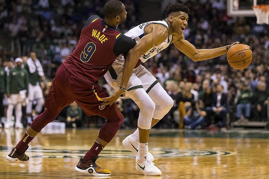 Cavaliers guard Dwyane Wade defending against Bucks forward Giannis Antetokounmpo on Tuesday. The latter led his team with 27 points as they beat the Cavs for the first time this season.