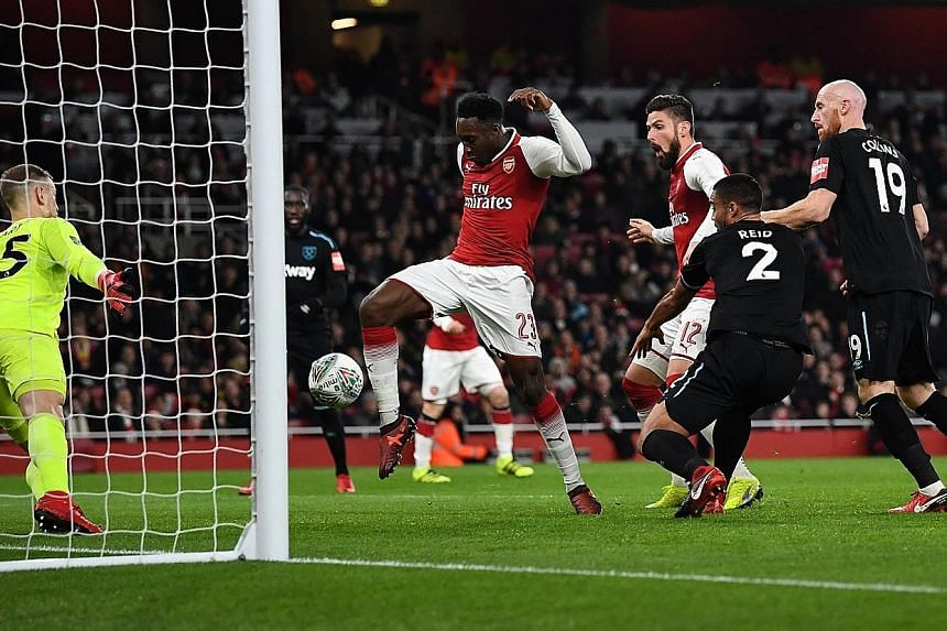 Arsenal's Danny Welbeck scoring the only goal of the game past West Ham's Joe Hart at the Emirates Stadium. Manager Arsene Wenger started with a totally changed XI but Olivier Giroud and Francis Coquelin left injured.