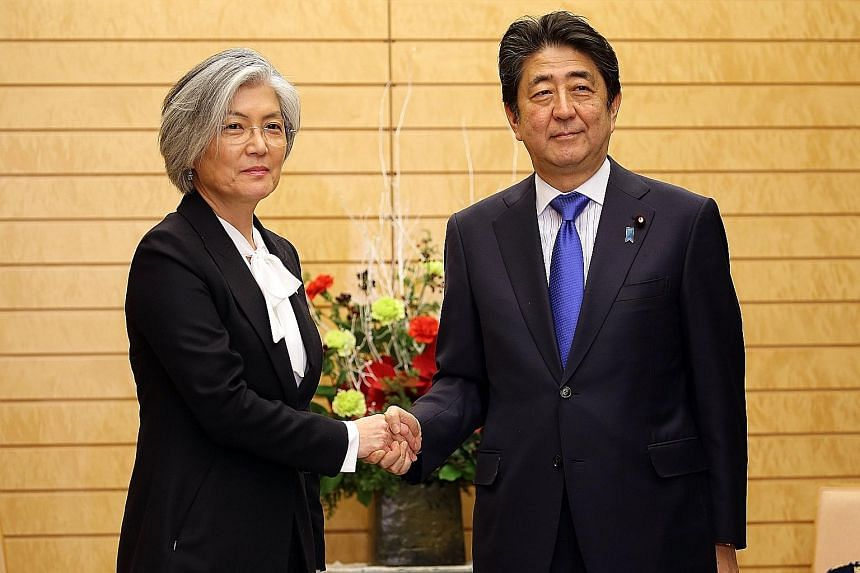 South Korea's Foreign Minister Kang Kyung Wha meeting Japanese Prime Minister Shinzo Abe in Tokyo on Tuesday.
