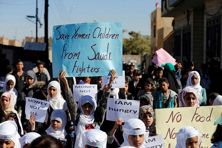 Children protesting against the Saudi-led coalition outside the UN offices in Sanaa, Yemen, last month.