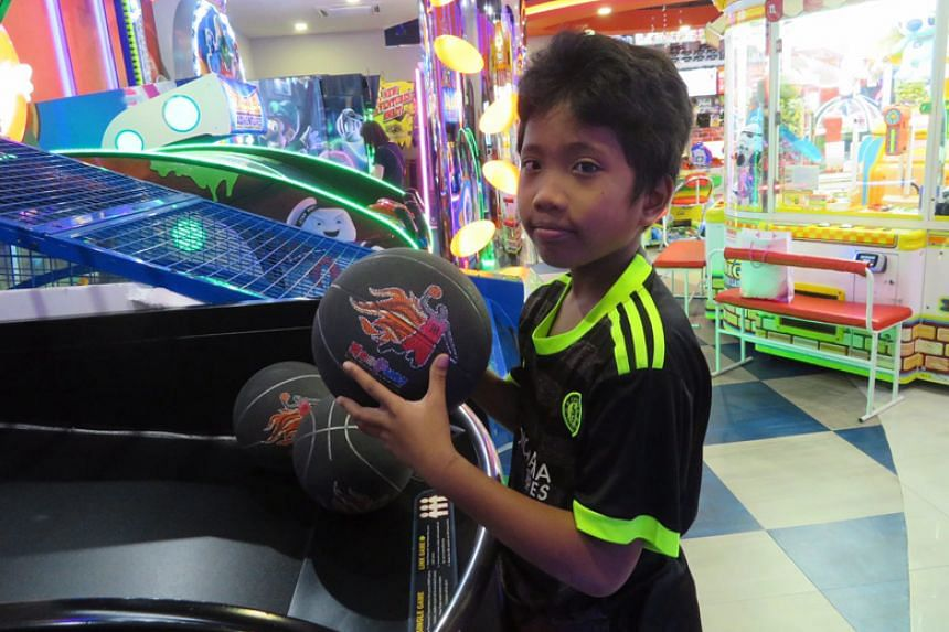 Mohd Hilmi bin Muhd Sanif, 10, visited an arcade for the first time, during Our Tampines Hub's community outreach event.