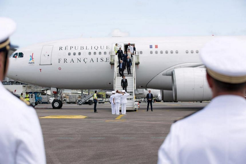 French President Emmanuel Macron descends from his plane at the Cayenne Felix-Eboue Airport at the start of his visit in Cayenne, Guyane, on Oct 26, 2017.