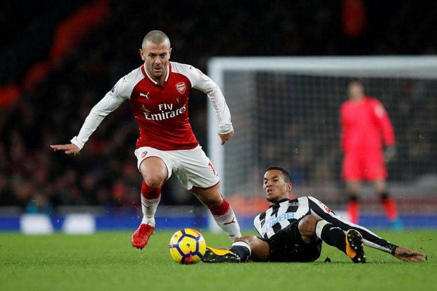 Arsenal's Jack Wilshere in action with Newcastle United's Isaac Hayden on Dec16, 2017