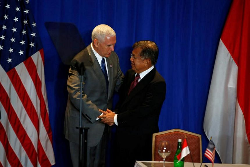 US Vice President Mike Pence shakes hands with Indonesian Vice President Muhammad Jusuf Kalla during a business forum in Jakarta on April 21.