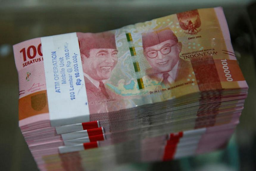 """Fitch lifted Indonesia's long-term, foreign currency-denominated debt ratings to """"BBB"""" from """"BBB-"""", with a stable outlook."""