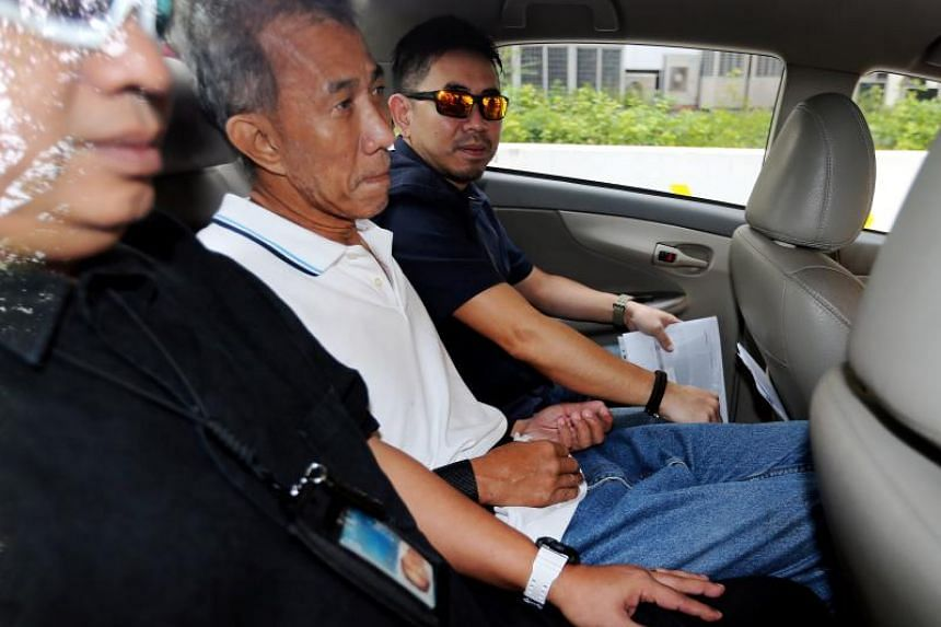 St Hilda's Church caretaker Yeo Liang Chai arriving at the State Courts in a police car on April 18, 2017.