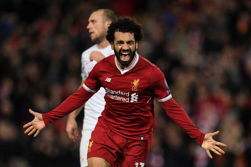 Liverpool's Egyptian midfielder Mohamed Salah celebrates scoring their seventh goal during the UEFA Champions League Group E football match against Spartak Moscow at Anfield in Liverpool.