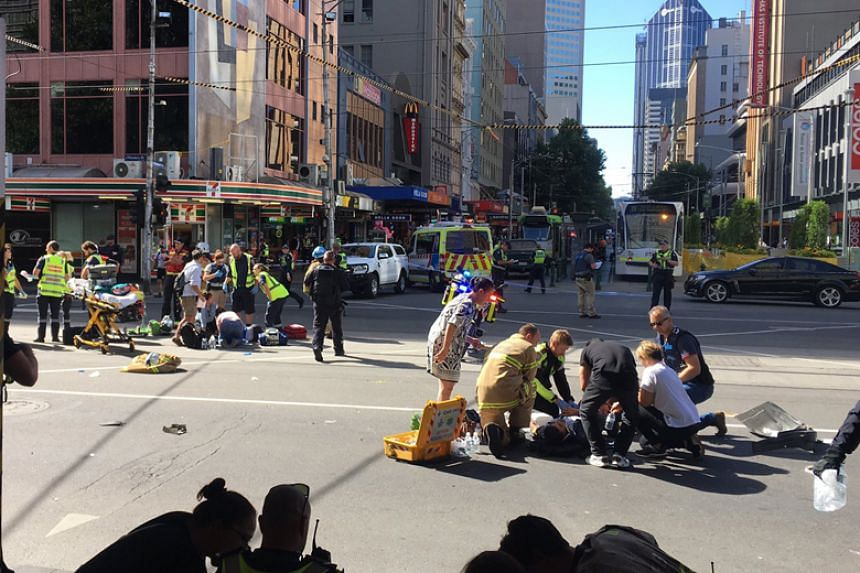 "A white SUV ""collided with a number of pedestrians"" on the corner of Flinders and Elizabeth streets in Melbourne on Dec 21, 2017."