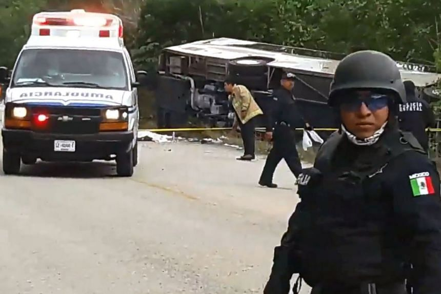 Mexican police officers standing guard near the bus in a video screengrab.