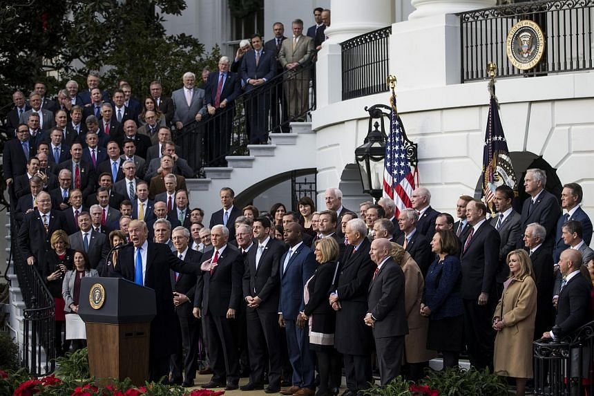 US President Donald Trump speaks during a tax bill passage event with Republican congressional members of the House and Senate on Dec 20, 2017.