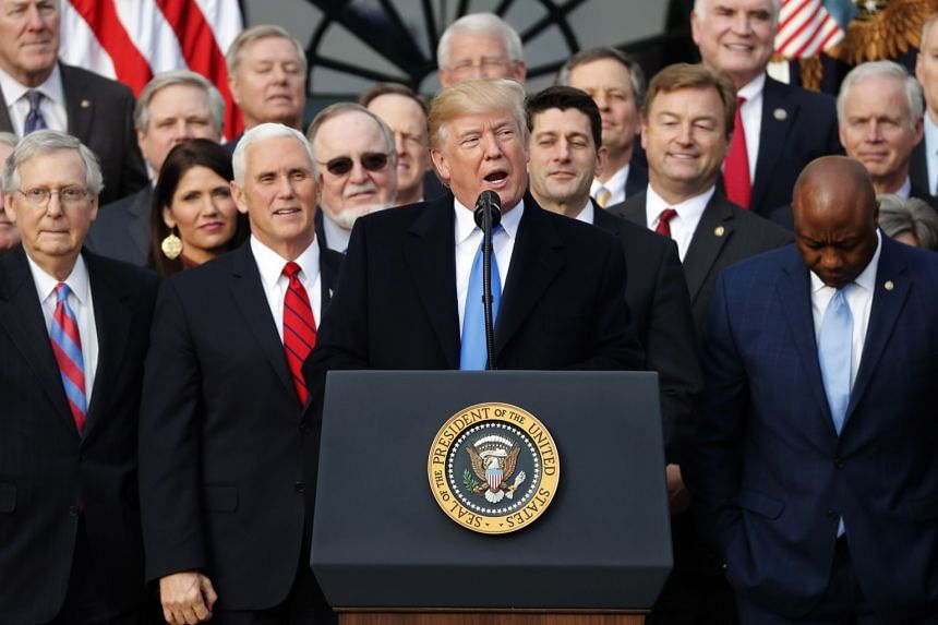 US President Donald Trump holds an event with Republican lawmakers to mark passage of sweeping tax overhaul legislation at the White House.