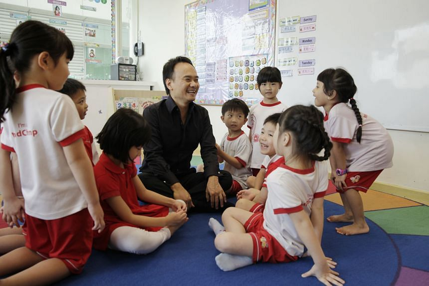 Mr David Chiem, founder of MindChamps PreSchool, with pupils in a MindChamps centre. The company has 10 company-owned and 44 franchisee-operated pre-schools and reading-and-writing centres across Singapore, Australia, the Philippines and the United A