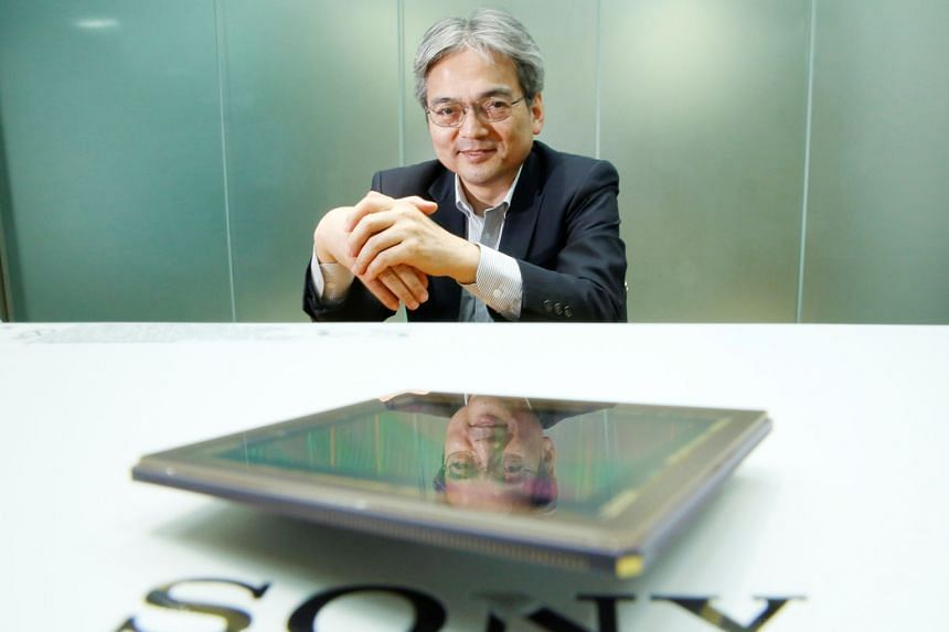 Mr Teruo Hirayama, technology chief of Sony's chip business, with the company's image sensor which has proved to be a winner.