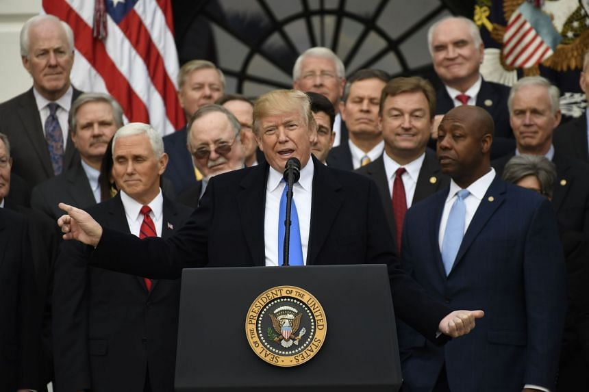 US President Donald Trump plans to sign the tax bill on Jan. 3 to ensure automatic spending cuts to Medicare and other programs don't take effect.