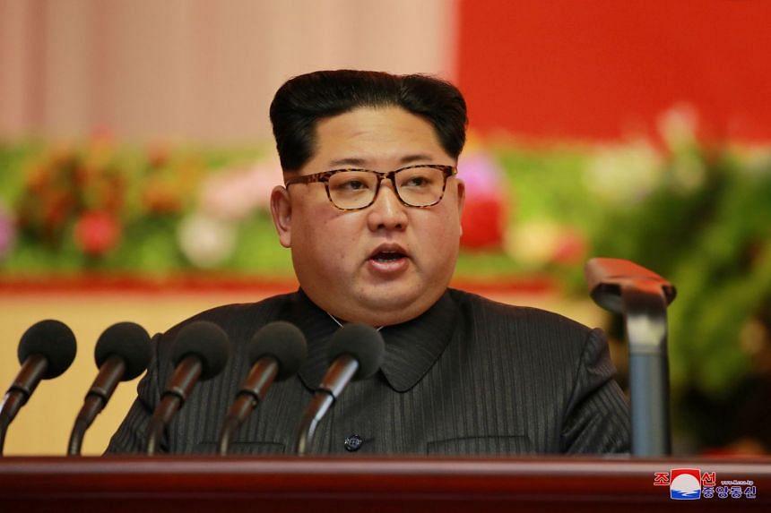 North Korean leader Kim Jong-Un attending an ammunitions industry convention.