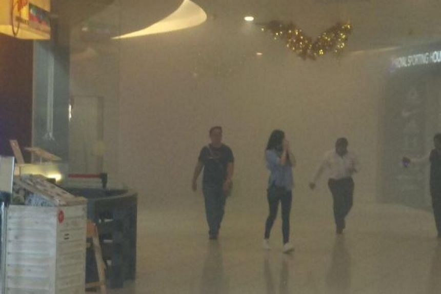 VivoCity shrouded in thick smoke on Dec 22, 2017, after a fire broke out at a Japanese restaurant.