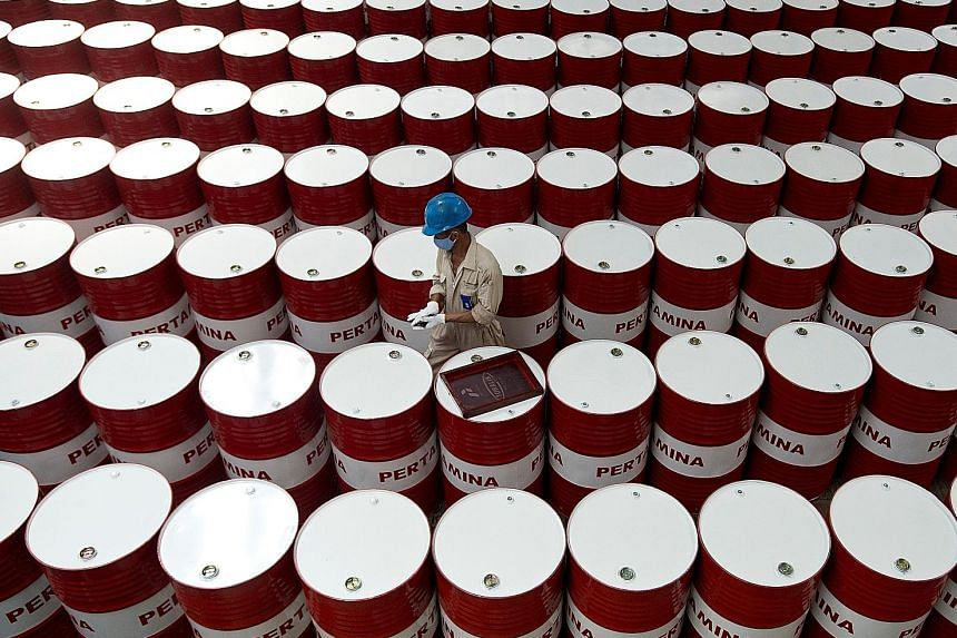 Barrels of lubricant oil at state oil firm Pertamina's facility in Central Java. Fitch expects Indonesia's GDP to rise 5.4 per cent next year and 5.5 per cent in 2019, from 5.1 per cent this year.