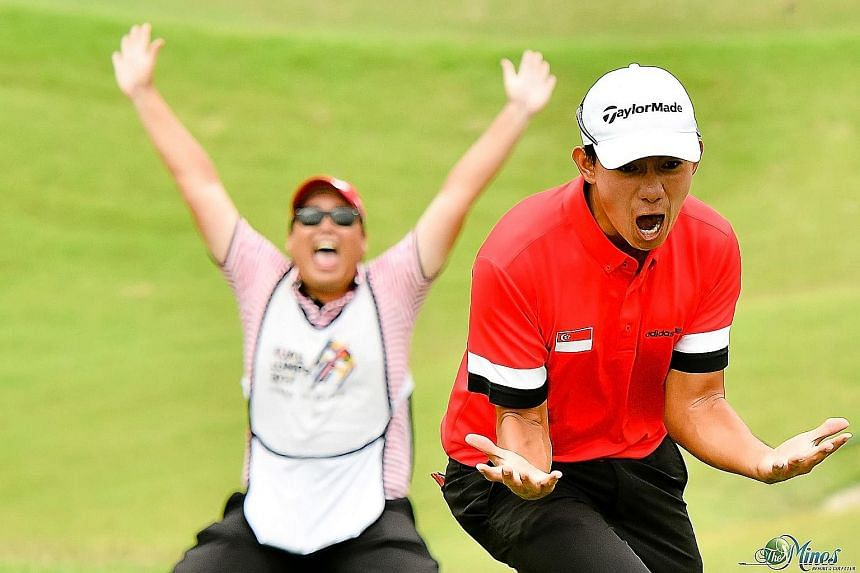 Golfer Marc Ong celebrates after winning a sudden-death play-off in the SEA Games team event against regional powerhouse Thailand.