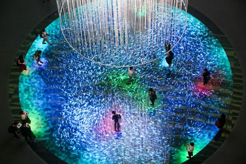 The new permanent exhibit has a 14m tall light installation hanging from the ceiling, above a circular floor spanning 15m in diameter and embedded with over 7.7 million LED lights.