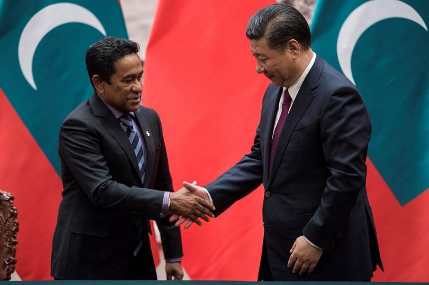 Maldives President Abdulla Yameen shakes the hand of China's President Xi Jinping after a signing ceremony at the Great Hall of the People in Beijing, China on Dec 7, 2017.