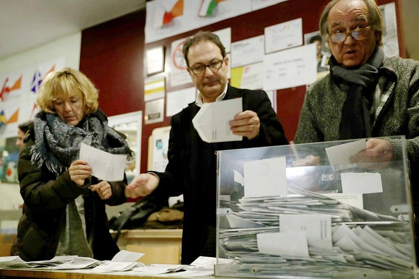 Officials count votes at a polling station in Barcelona, Catalonia, on Dec 21, 2017.