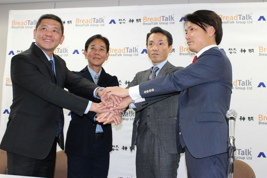 (From left) BreadTalk Group chief executive officer Henry Chu, chairman George Quek, Shinmei Corp President Mitsuo Fujio and Shinmei USA Corporation chief executive officer Mitsuzo Fujio at a news conference at Shinmei Corp's headquarters in Kobe on