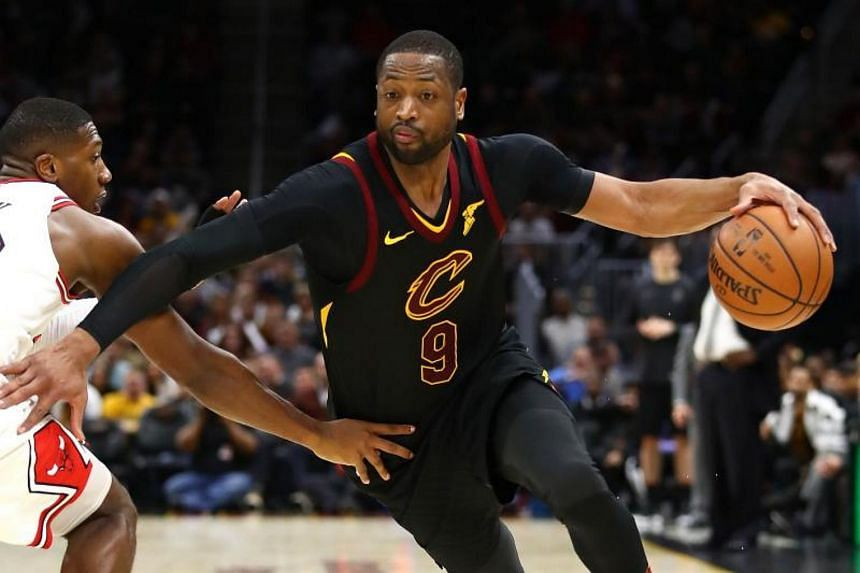 Dwyane Wade of the Cleveland Cavaliers drives around Kris Dunn of the Chicago Bulls during the second half at Quicken Loans Arena in Cleveland, Ohio, on Dec 21, 2017.