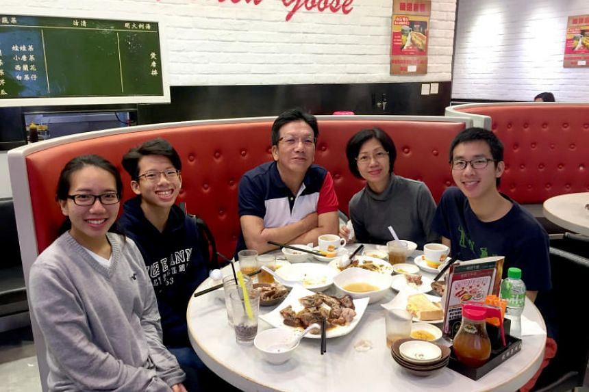 Architect Loo King Keong, 57, with his wife, Ho Lai Heng, 51, and three children (from left) Alethea, 22, Augustin, 15, and Adriel, 24, eating at a Hong Kong restaurant during their holiday.