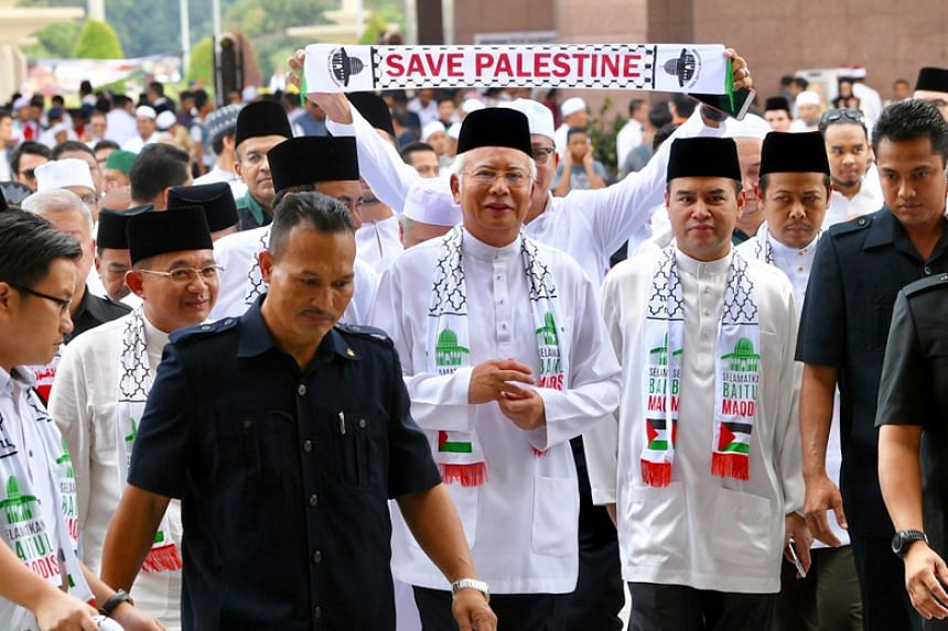 """Malaysian Prime Minister Najib Razak arriving at the Putra Mosque for Friday prayers before leading the """"solidarity rally to save Jerusalem"""" on Dec 22, 2017."""