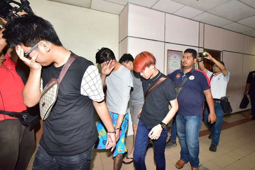 Two men, aged 19 and 23, will be charged at the magistrate's court with murdering a 44-year-old man, believed to be a gang leader, at a petrol station in Johor Baru, last month.