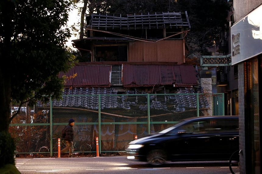An old house whose owners had been not known for a long time and which has blocked construction of road in Omiya, Saitama, Japan, on Dec 20, 2017.