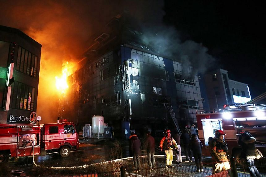 A fire engulfed a commercial building in the southern city of Jecheon, South Korea, on Dec 21, 2017.