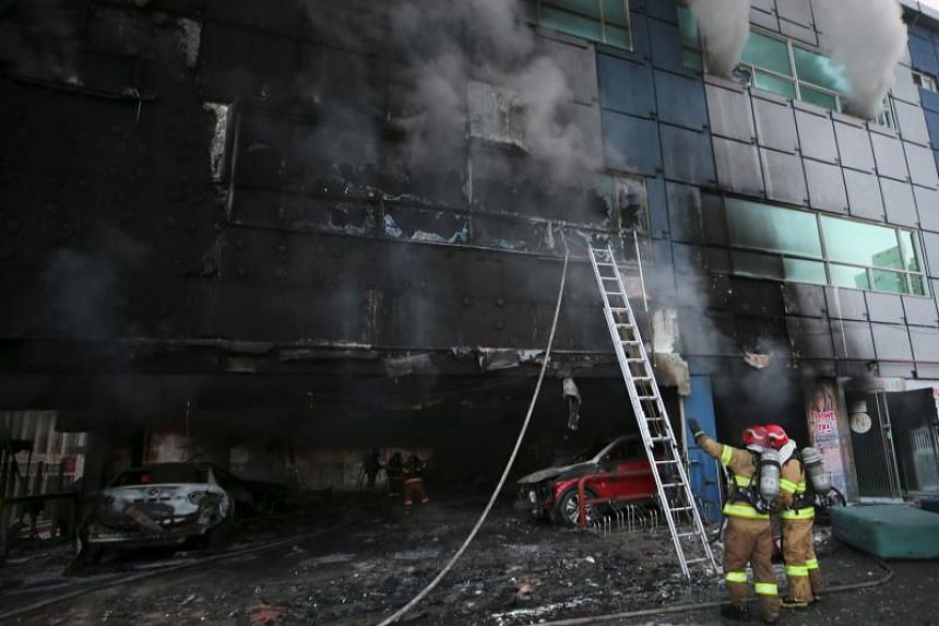 Firefighters searching for survivors after a fire broke out in an eight-storey building in Jecheon, 120 km southeast of Seoul, on Dec 21, 2017.