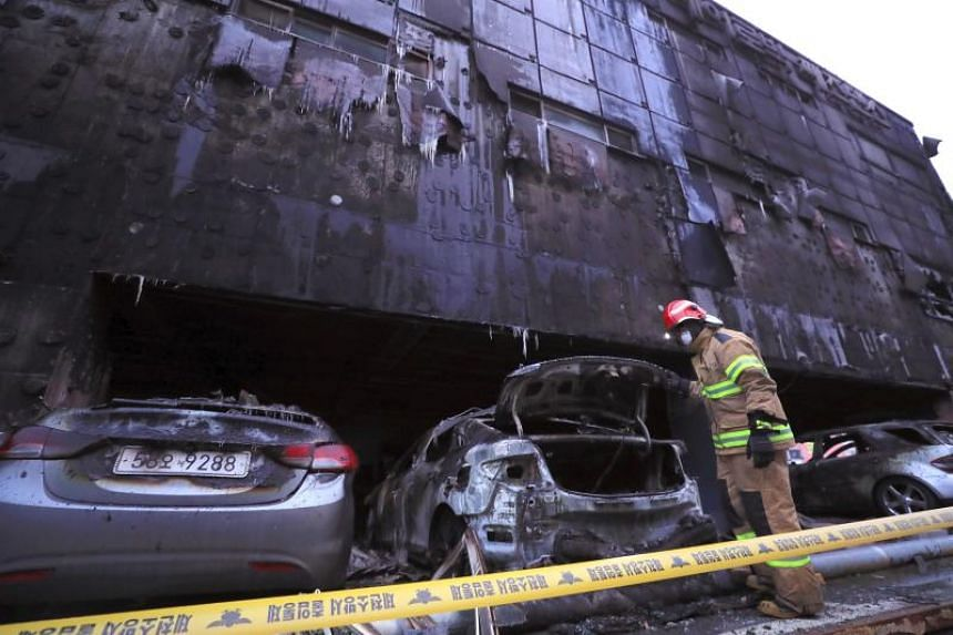 A firefighter searching through an eight-storey building damaged by a fire that killed 29 people in the southern city of Jecheon on Dec 21, 2017.