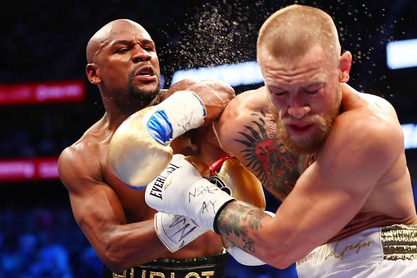 Floyd Mayweather landing a left hook on Conor McGregor during their blockbuster bout in August. With McGregor then making the crossover into the boxing ring for that fight, Mayweather has been touted to do a switch in the opposite direction.