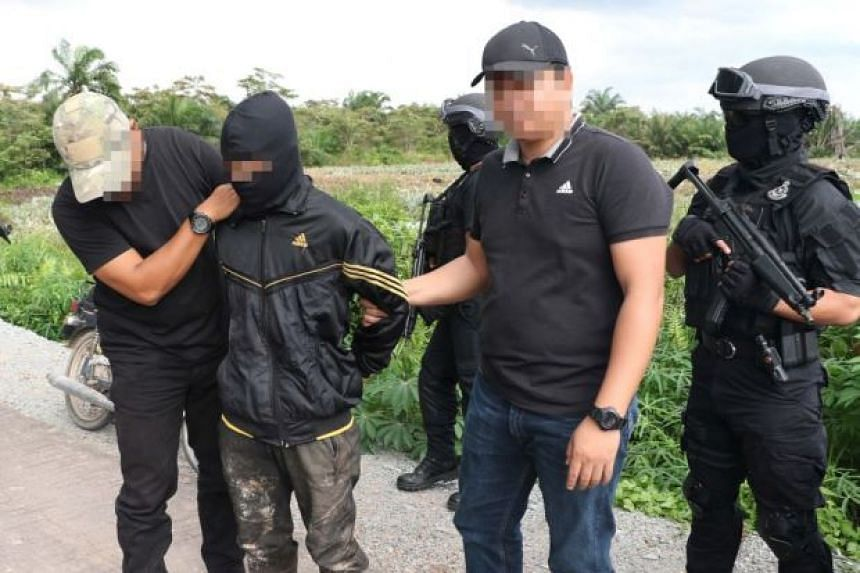 Malaysian counter-terrorism officers detaining a suspect in Pontian, Johor. 20 people were arrested in different states between Nov 30 and Dec 15 for their alleged involvements in terrorist activities.