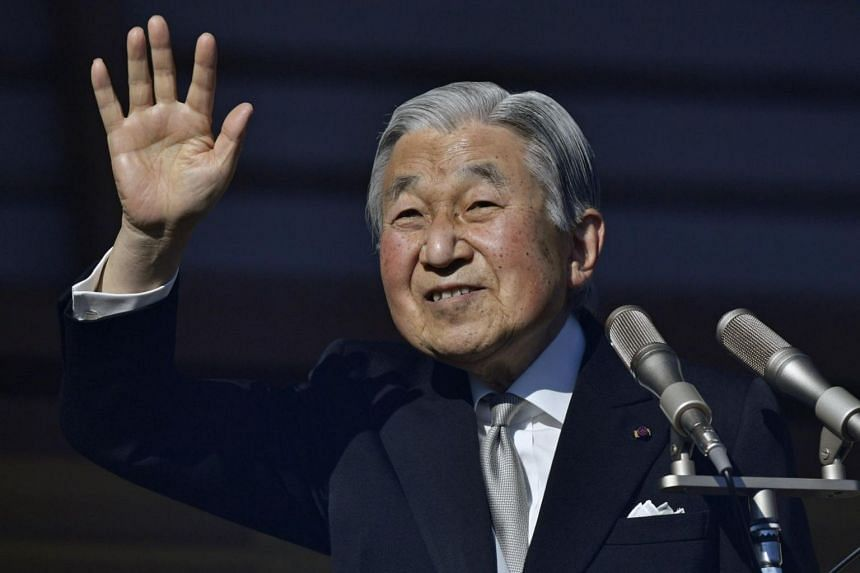 Japan's Emperor Akihito waves to well-wishers celebrating his 84th birthday at the Imperial Palace in Tokyo, Japan.
