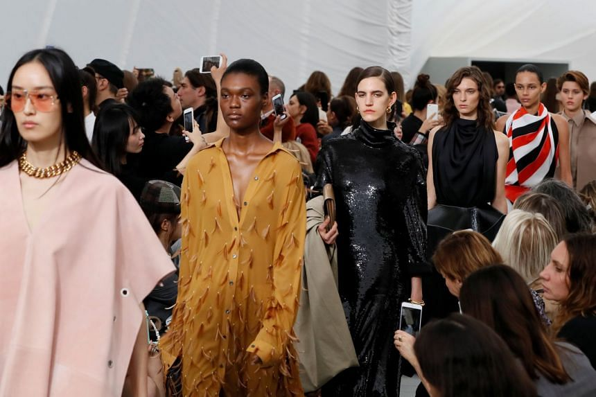 Models present creations by Philo as part of her Spring/Summer 2018 ready-to-wear collection for Celine.