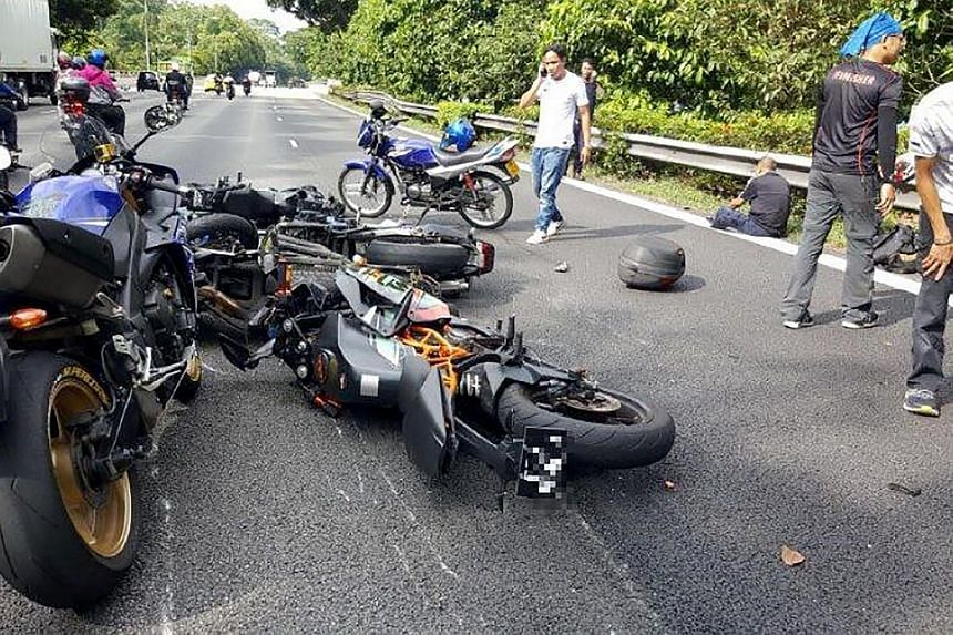 Motorcycles strewn on the Bukit Timah Expressway (BKE) yesterday afternoon. Two accidents took place on the same stretch of road about an hour apart. A total of six motorists were injured in the two accidents, most of them motorcyclists.