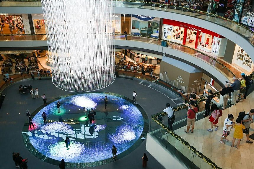 Digital Light Canvas has a 14m-tall light installation hanging from the ceiling, above a circular floor embedded with LED lights. Visitors can pay to walk on the LED floor, which renders graphics.