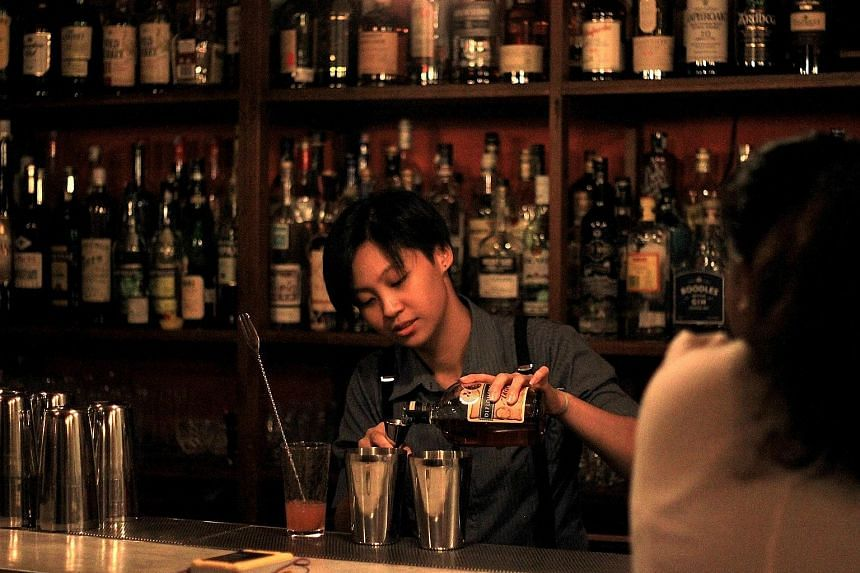 Young urbanites are willing to splash out on cocktails made by artisan bartenders at speakeasies such as Omakase + Appreciate (above), one of the first such bars in Malaysia.