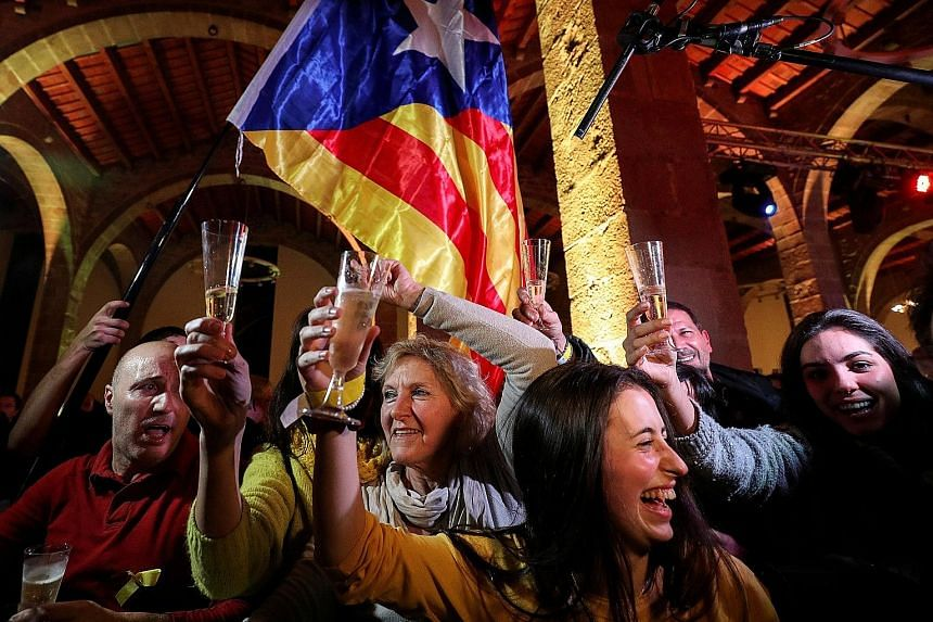 People at a gathering organised by the Catalan National Assembly, an organisation that supports independence for Catalonia, reacting to the results of the regional election, in Barcelona, on Thursday. The election outcome could allow separatists to r