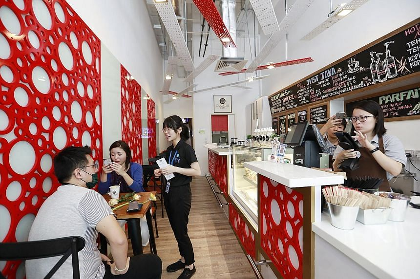 Patrons at the newly opened Ducatus Cafe in Robinson Road, which accepts cryptocurrencies such as bitcoin. The cafe also has a bitcoin ATM.