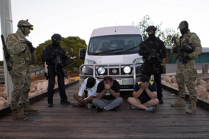 """Police watching over suspects after 1.2 tonnes of """"ice"""" in large sacks was seized after it was offloaded from a boat in Western Australia on Thursday."""