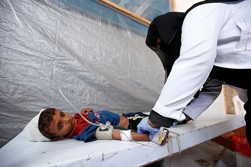 A nurse attending to a cholera-infected child at a treatment centre in the Red Sea port city of Hodeidah in Yemen in October. Cholera flared up in April and spread rapidly, killing 2,227 people.